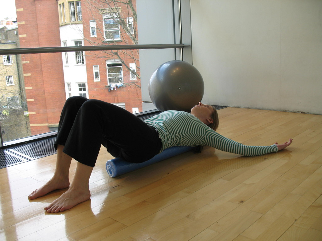Thoracic stretch on foam roller (Tiffany Pritchard Pilates), Image taken by Meghan Horvath at The Place